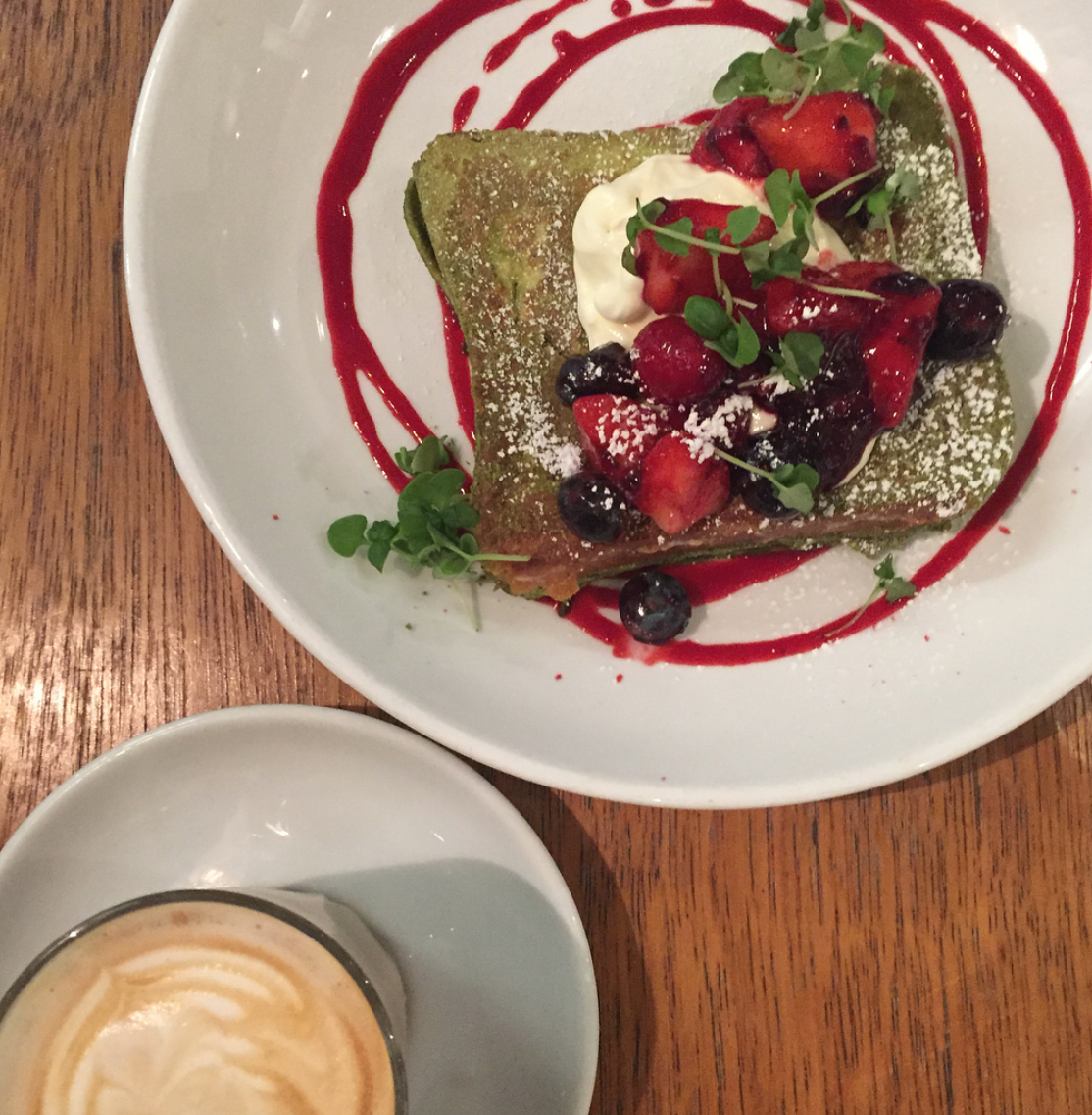lantana french toast – with matcha powder, icing sugar, berries, coulis and a healthy dollop of thick cream. Flat white also pictured just in the shot.