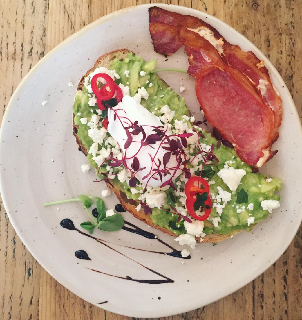 trading post brighton review - avocado, feta, bacon and a poached egg on a single slice of sourdough